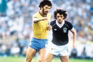 Legend: Scotland's John Wark marks Brazilian captain Socrates at the 1982 World Cup Finals in Seville, Spain on June 18, 1982.