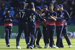 England players celebrate after dismissing a New Zealand batsman during an ICC Champions Trophy 2017 match in Cardiff. Get full cricket score of England vs New Zealand match here