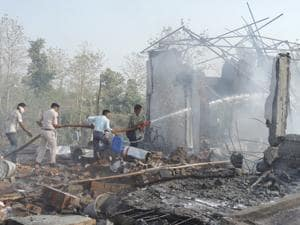 Rescuers try to douse  fire at a firecracker factory in Balaghat, Madhya Pradesh on Wednesday.  Police arrested owner of the factory from Chhattisgarh on Friday.