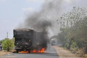 Villagers burn vehicles on the Mhow-Neemuch highway in Mandsaur.