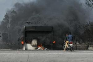 A toll booth set on fire by agitating farmers in Madhya Pradesh.