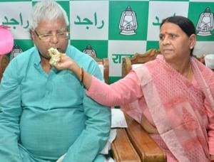 Ex-CM Rabri Devi offering cake to husband, RJD chief Lalu Prasad, on his 70th birthday, in Patna on Sunday.