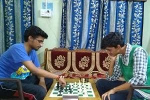 Playing chess helped Adarsh Srivastava (left) master the right moves to crack IIT-JEE Advanced .