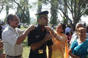 Lt Nitish Kakkar with his parents in 2015.