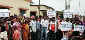 People protest after the announcement of the closure of Dhanbad Chandrapura rail line at Phulwartad station in Dhanbad