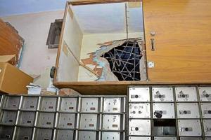 The thieves made a two-feet-wide hole to enter the strongroom and broke open 30 out of 435 lockers.