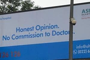 The hoarding put up by the hospital.
