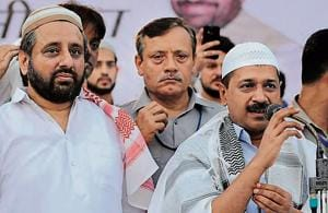 Delhi chief minister Arvind Kejriwal and AAP MLA Amanatullah Khan at an Iftar at Ansari Auditorium, in Jamia Milia Univeristy, in New Delhi on Thursday.