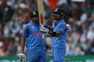 India's Rohit Sharma celebrates with captain Virat Kohli during ICC Champions Trophy 2017 semi-final against Bangladesh. Get highlights of India vs Bangladesh here .