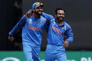 India captain Virat Kohli (L) celebrates with Kedar Jadhav (R) after they combine to take the wicket of Bangladesh batsman Mushfiqur Rahim during the ICC Champions Trophy semi-final at Edgbaston in Birmingham.