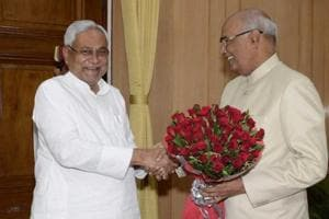 Chief minister Nitish Kumar greets Bihar governor and NDA presidential nominee Ram Nath Kovind at governor's house in Patna on Monday.