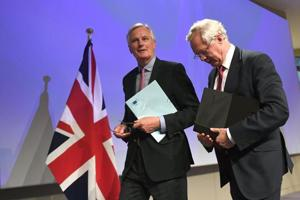 Britain bows to EU Brexit talks timetable