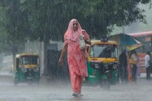 PHOTOS: Delhi wakes to record rain, waterlogging and traffic...