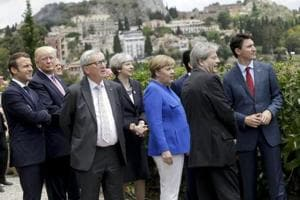 French President Emmanuel Macron, U.S. President Donald Trump, EU Commission President Jean-Claude Juncker, British Prime Minister Theresa May, German Chancellor Angela Merkel, Italian Prime Minister Paolo Gentiloni and Canadian Prime Minister Justin Trudeau at a G7 meeting