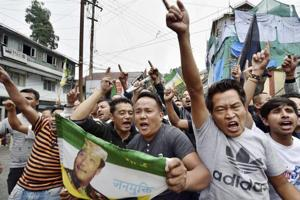 Darjeeling: Gorkha Janamukti Morcha supporters shout slogans at a protest rally during their indefinite strike in Darjeeling on Monday.