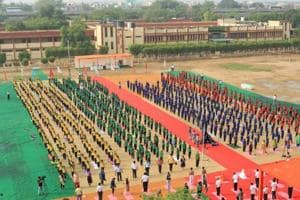 Students stretch, bend to mark International Yoga Day