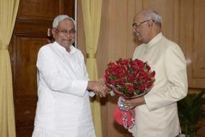 Bihar chief minister Nitish Kumar greets Bihar governor and NDA presidential nominee Ram Nath Kovind at governor