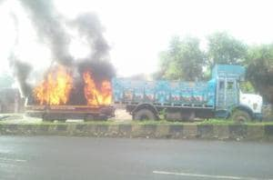 Farmers set ablaze a police van in Nevali.