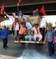 Farmers spill milk on a Nashik street during a protest seeking farm loan waiver, earlier this month.