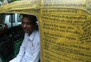 This auto driver in Delhi writes phrases on his vehicle that promote...