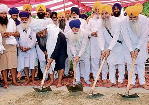 SGPC chief Kirpal Singh Badungar (third from right) with others, laying foundation stone of 'chhabeel' stalls on approach road to Golden Temple in Amritsar on Friday.