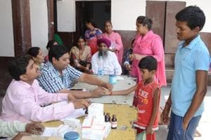 Health department officials examining patients at medical camp after diarrhoea outbreak in Makkar Colony in Ludhiana on Friday.