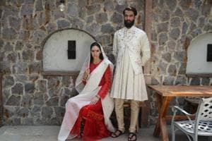 Model Arnela Zekovic in a white tussar silk sari draped over a red ruffled dress; Model Vishwaraj Singh Lavera in a  circular kurta teamed with churidaar and floral Nehru jacket
