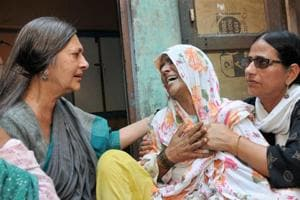 CPI(M) politburo member Brinda Karat consoles the mother of Junaid, who was lynched by a mob on board a train, in Haryana on Saturday.