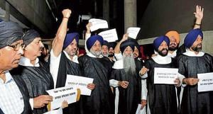 BLACKROBEPROTEST: (From left) Three non-Sikh MLAs — BJP's Som Parkash and Arun Narang, and SAD's NK Sharma — wear 'patka' and turban to express solidarity in protest with SAD chief Sukhbir Badal and others, at the Vidhan Sabha complex in Chandigarh on Friday.
