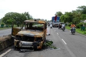 A vehicle damaged in Thursday's protests on the road leading to Nevali near Mumbai