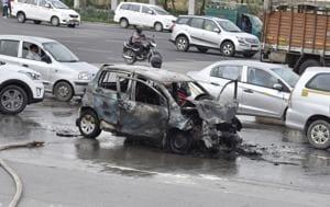 Car catches fire on Delhi Gurgaon Expressway