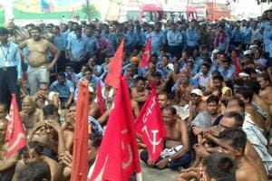 Laid off employees of Hero Cycles intensified their protest by removing their clothes in Ludhiana on Saturday.