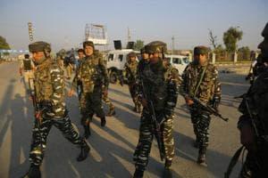 Army personnel cordon off the area surrounding the Delhi Public School after militants attacked a CRPF patrol party, killing a sub-inspector, in Srinagar