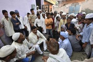 Local residents gather outside the residence of Hafiz Junaid in Faridabad on Friday.