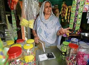 65-year-old Rajkor runs a shop in Surakhpur village. The swipe machine has hardly been used to accept payments because there is poor internet connectivity in the village.