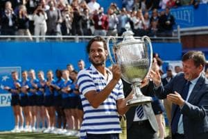 Feliciano Lopez raises the trophy after winning the men