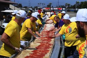 1.9-km-long pizza made by 100 chefs sets Guinness record for world's...