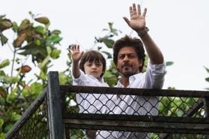 Eid mubarak: Shah Rukh Khan greets fans with AbRam by his side outside...