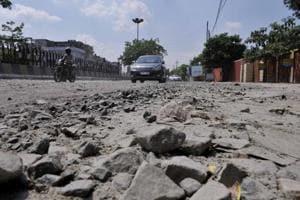 Yogi government at 100 days: Slipping up on potholed roads