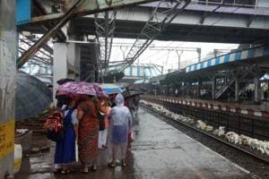 Rains in Mumbai make travelling by train a nightmare for commuters