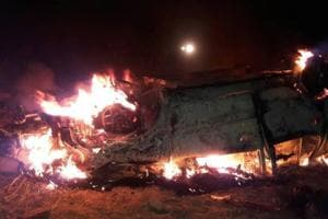 Attackers burnt alive two persons trapped inside a Tata Safari and lynched three others at Rae Bareli 's Etaura Bujurg village.