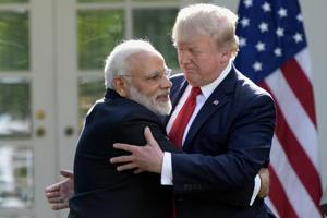 US President Donald Trump (R) and Indian Prime Minister Narendra Modi speak to the press in the Rose Garden of the White House in Washington, DC, on June 26, 2017. / AFP PHOTO / SAUL LOEB