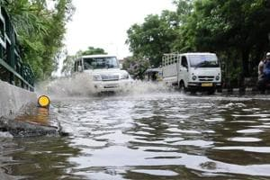 The road dividing Sector 6970 was inundated after heavy showers last week