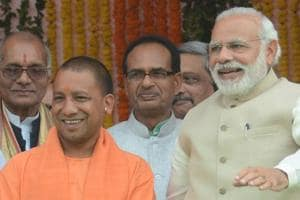 PM Modi and Yogi Adityanath as he was sworn-in as the Uttar Pradesh CM.