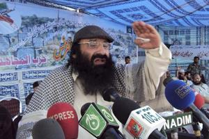 In this July 13, 2011 file photo, Syed Salahuddin, the supreme commander of Hizbul Mujahideen, addresses his supporters in Muzaffarabad capital of Pakistan-occupied Kashmir.