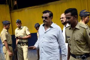 Mustafa Dossa leaves from Arthur Road Jail in Mumbai.
