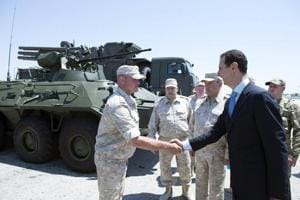 Syrian President Bashar al-Assad visits Russian air base
