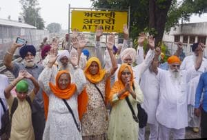 Pilgrims protesting at the Attari railway satiation in Amritsar on Wednesday.