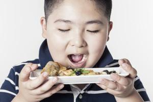 Is your teenage son overweight? It might up his risk of getting a...