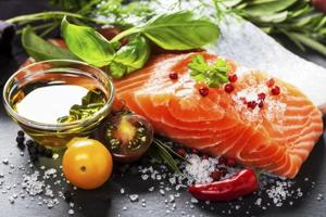 Include salmon and walnuts in your diet to fight bowel cancer, says...